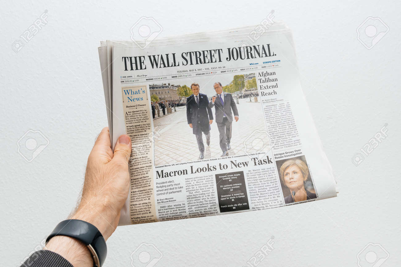 PARIS, FRANCE - MAY 10, 2017: Man Holding The Wall Street Journal ...