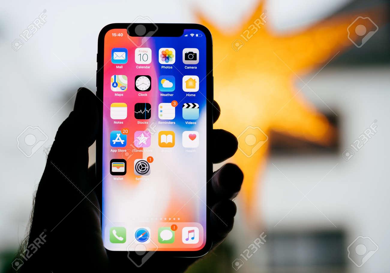 best website 73f3a ffb8d PARIS, FRANCE - NOV 10, 2017: Man holding the new Apple iPhone..