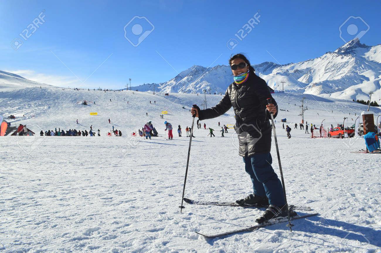 young woman having fun skiing at las lenas as ski resort in mendoza