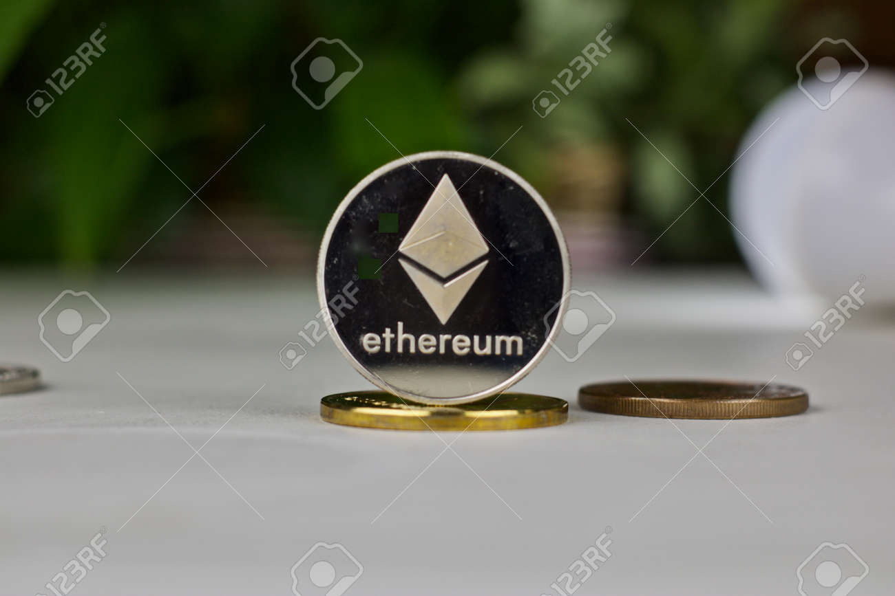 Digital currency physical ethereum coin  Cryptocurrency concept