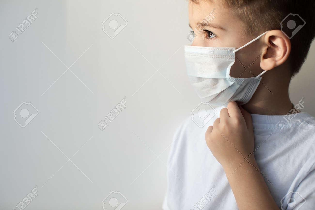 Concept of coronavirus quarantine. Child in mask . Protection against virus, infection. Health. Medical virus poster design - 143589442