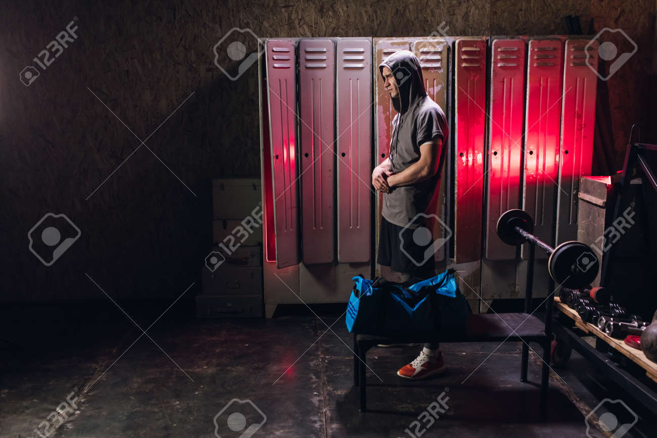 Man get ready for boxing training in the locker room - 164447737