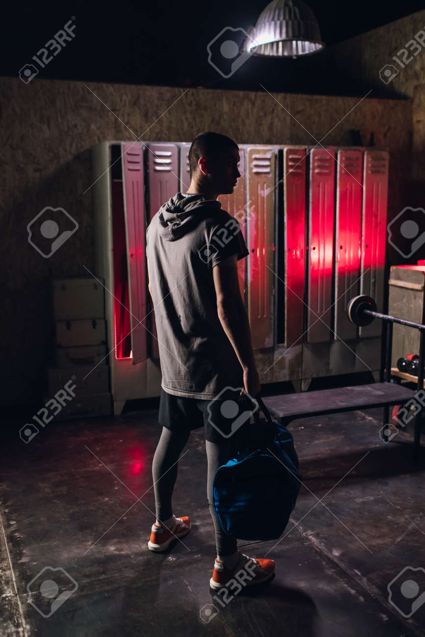 Man get ready for boxing training in the locker room - 164447745