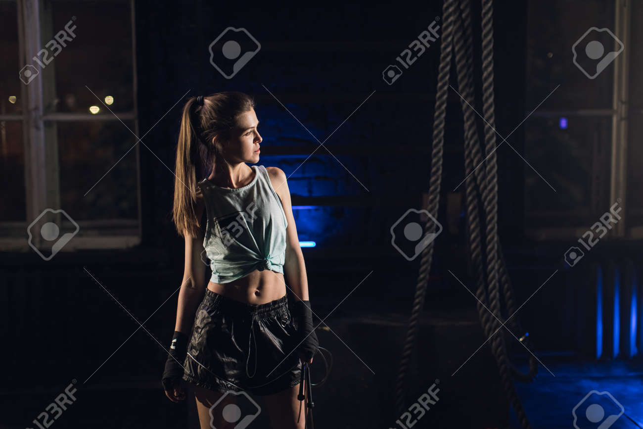 Young girl stands in an atmospheric gym. Sport - 164447801