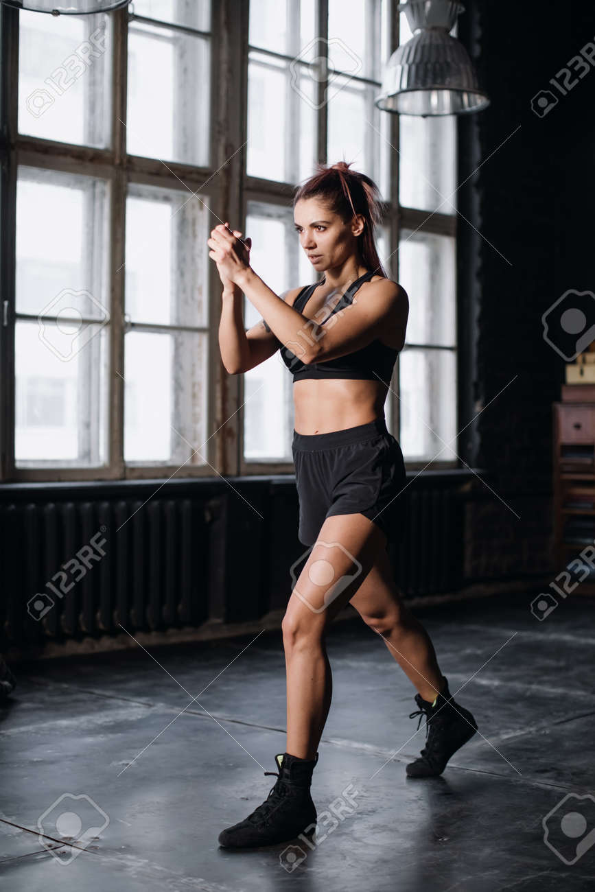 Young girl doing sports in the gym. Atmospheric gym - 164447806