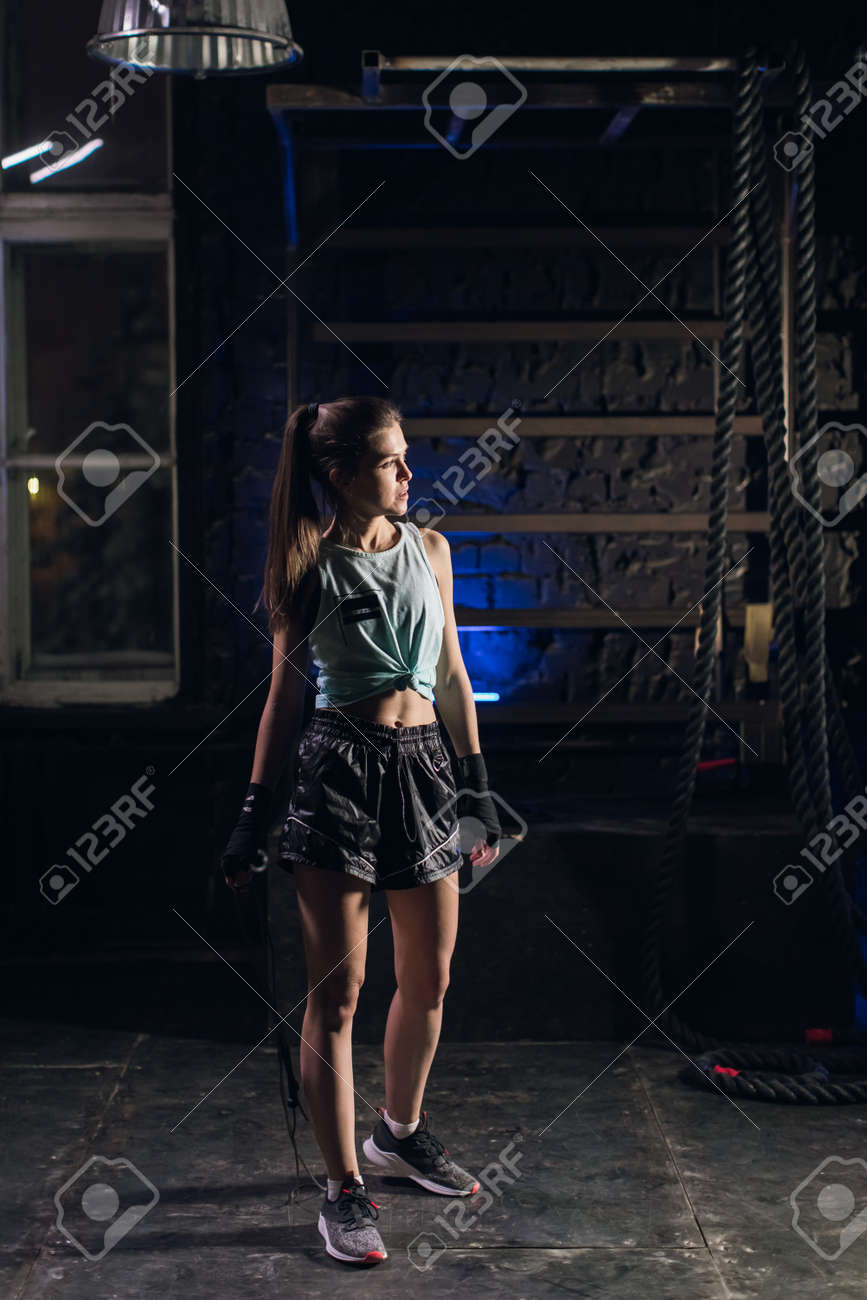 Young girl stands in an atmospheric gym. Sport - 166083819