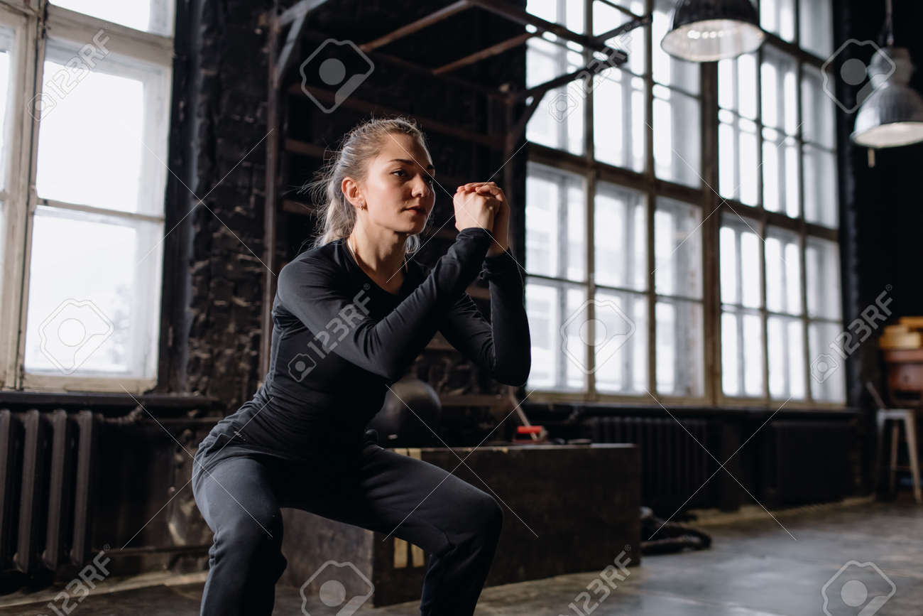 Young girl doing sports in the gym. Atmospheric gym - 166083833