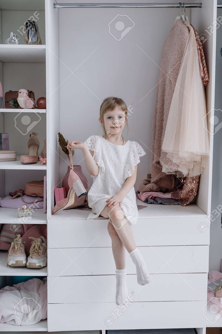 Portrait of A Little Girl in A Beautiful Dress. Girl looks at the camera - 166079659