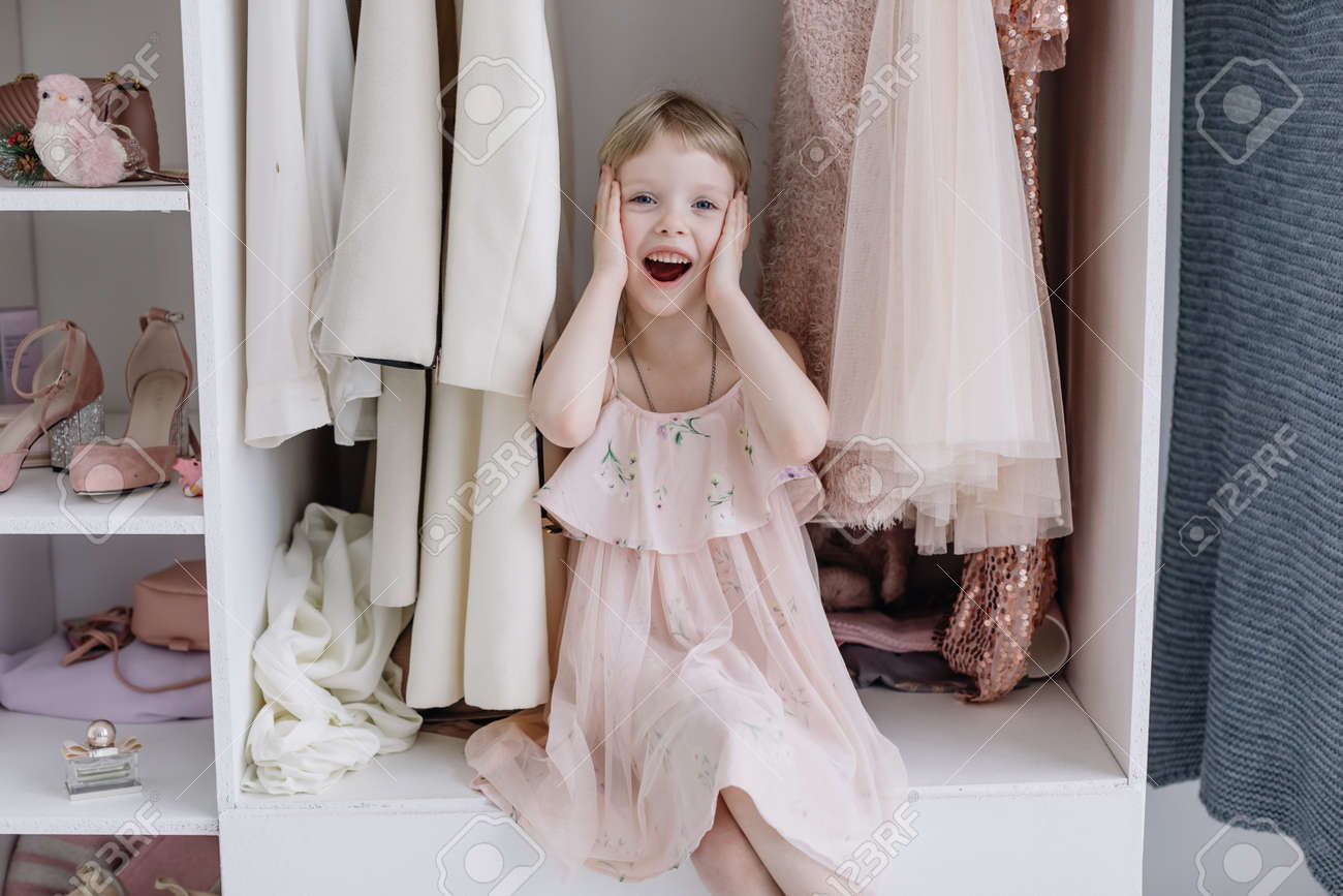 Portrait of A Little Girl in A Beautiful Dress. Girl looks at the camera - 166083836