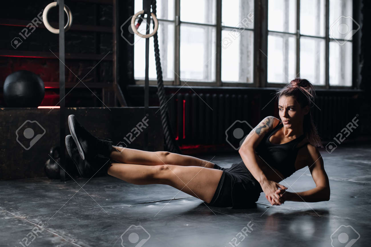 Young girl doing sports in the gym. Atmospheric gym - 166782019