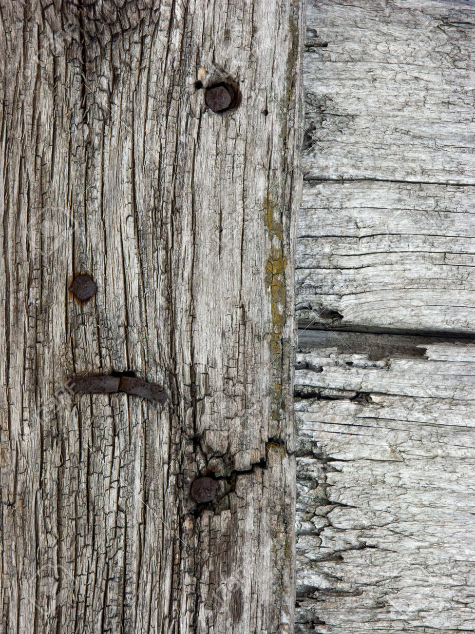Panels and wooden boards of a rural house, used for doors, windows and cellars, painted and eroded by time. - 135456703