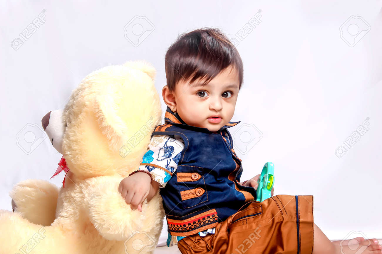 Cute Indian Baby Child Playing With Toy Stock Photo Picture And Royalty Free Image Image 124847822