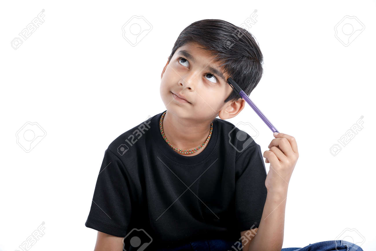 Cute Indian boy thinking idea and looking at up, isolated on white background - 124972912