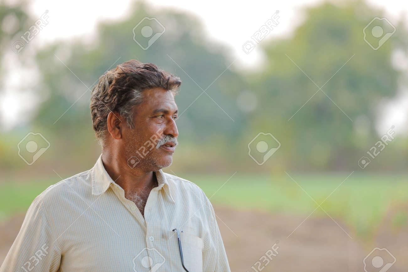 Indian farmer at field - 124974436
