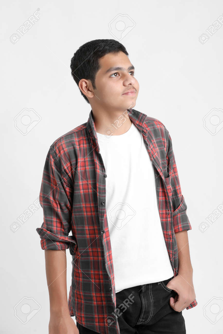 Young indian boy in a casual outfit and showing expression on white background. - 167080278