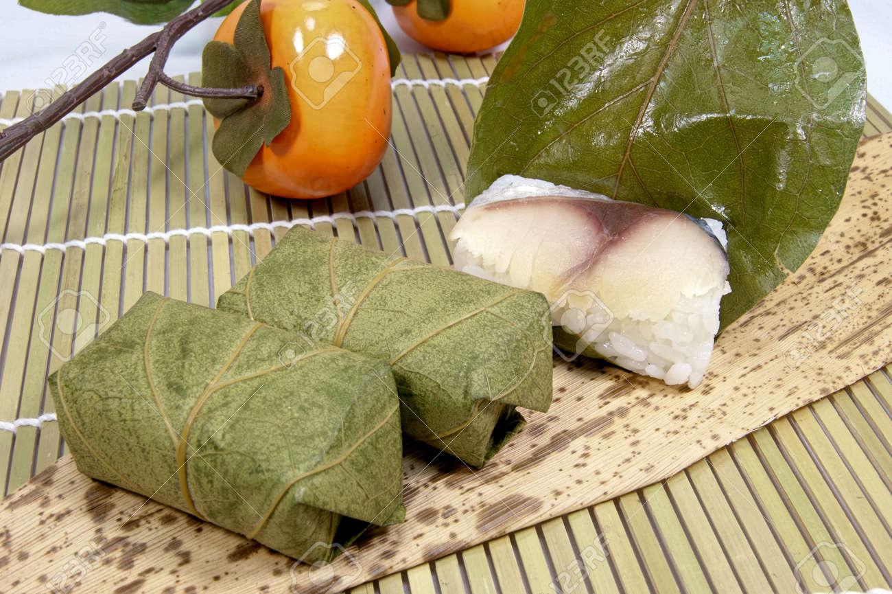 Persimmon leaf sushi - 52394724