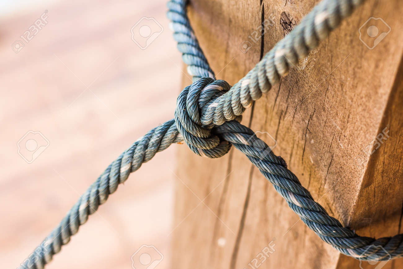 Male hands tie a rope treerope knot line tied together with male hands tie a rope treerope knot line tied together with nature background biocorpaavc Choice Image