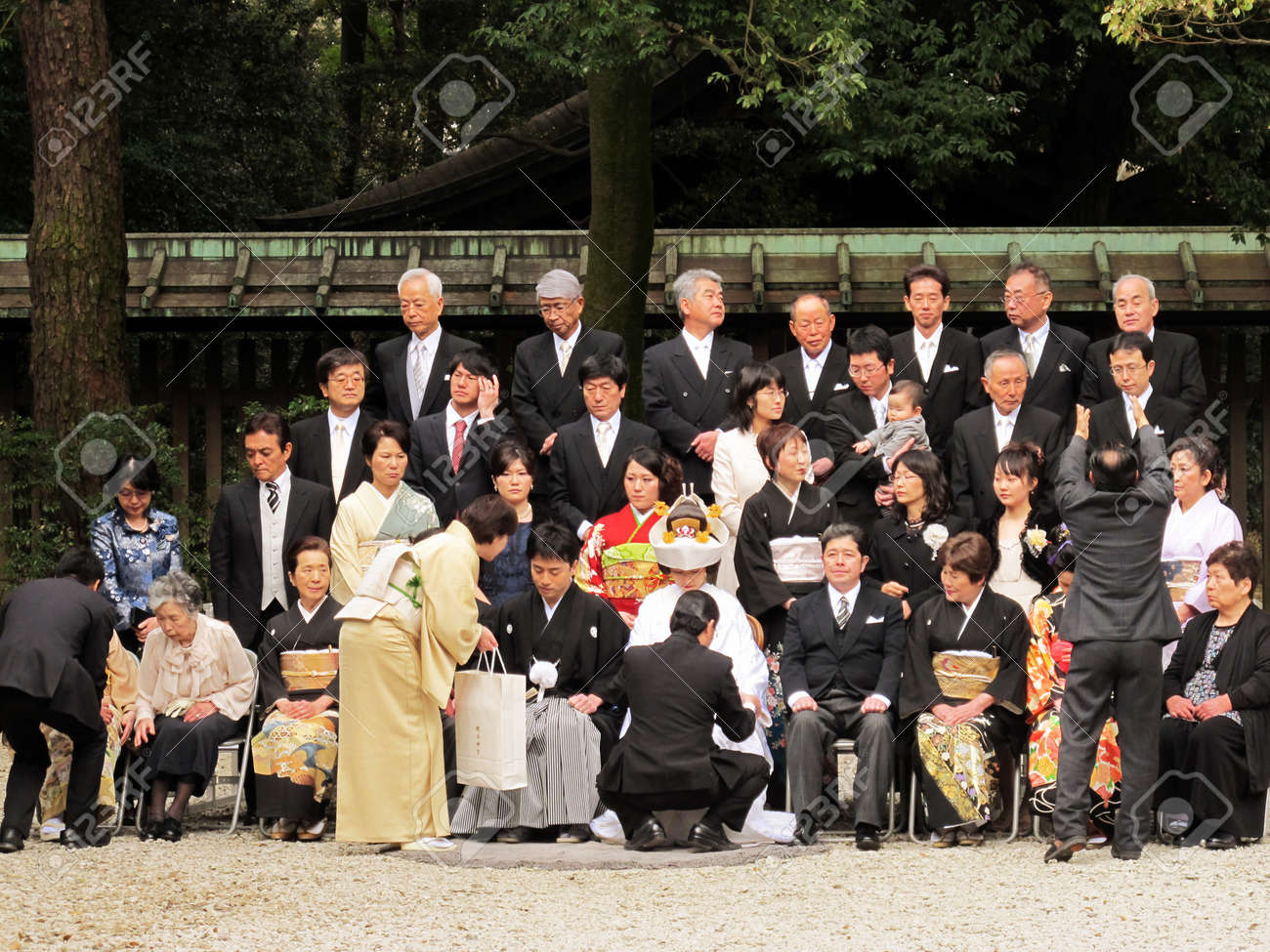 HARAJUKU,TOKYO - MARCH 25, 2012: Celebration of a typical wedding ceremony in Meiji Jingu Shrine Harajuku Tokyo, Japan. Stock Photo - 17262297
