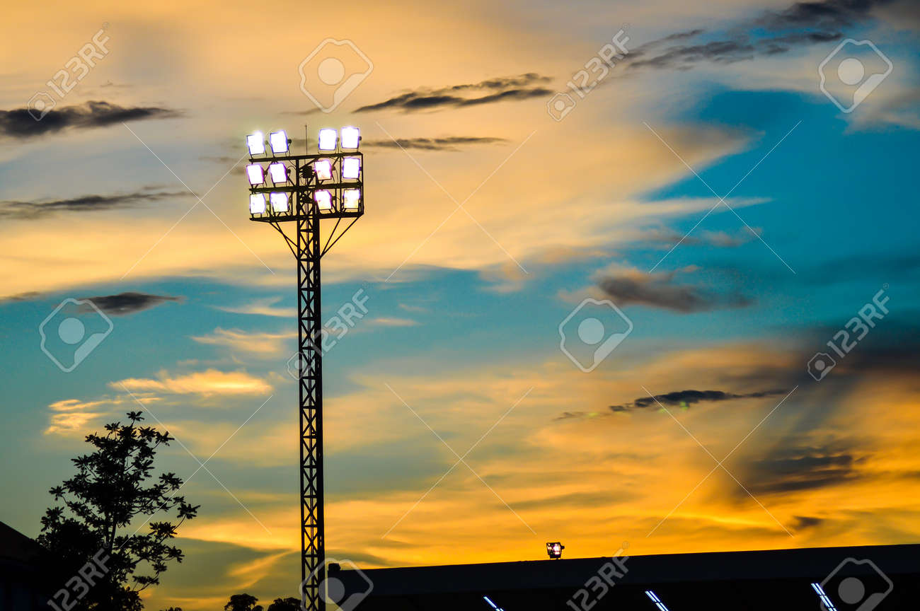 Pillar spotlights football field in the background blue sky at sunset Stock Photo - 20103047