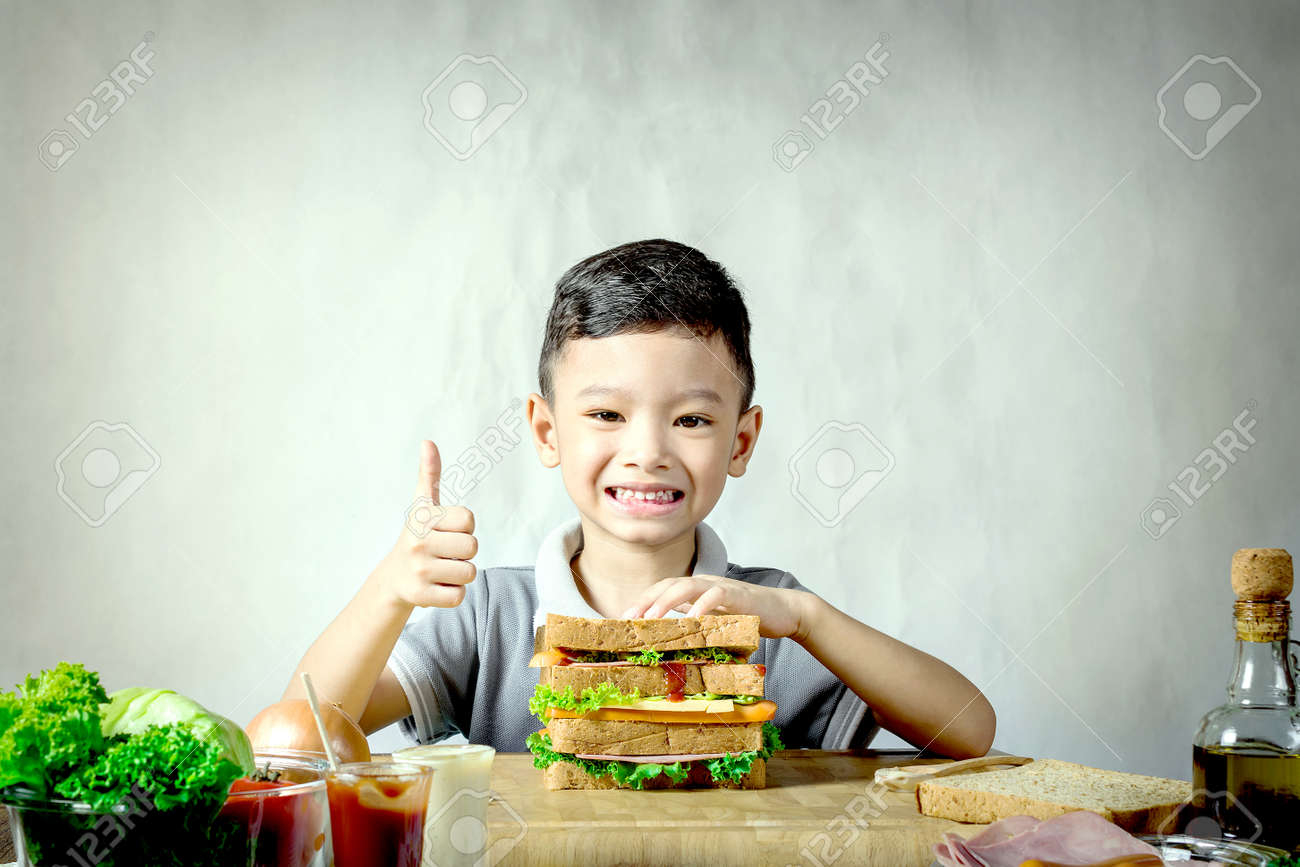 Little Boy Making A Sandwich In Kitchen Stock Photo, Picture And ...