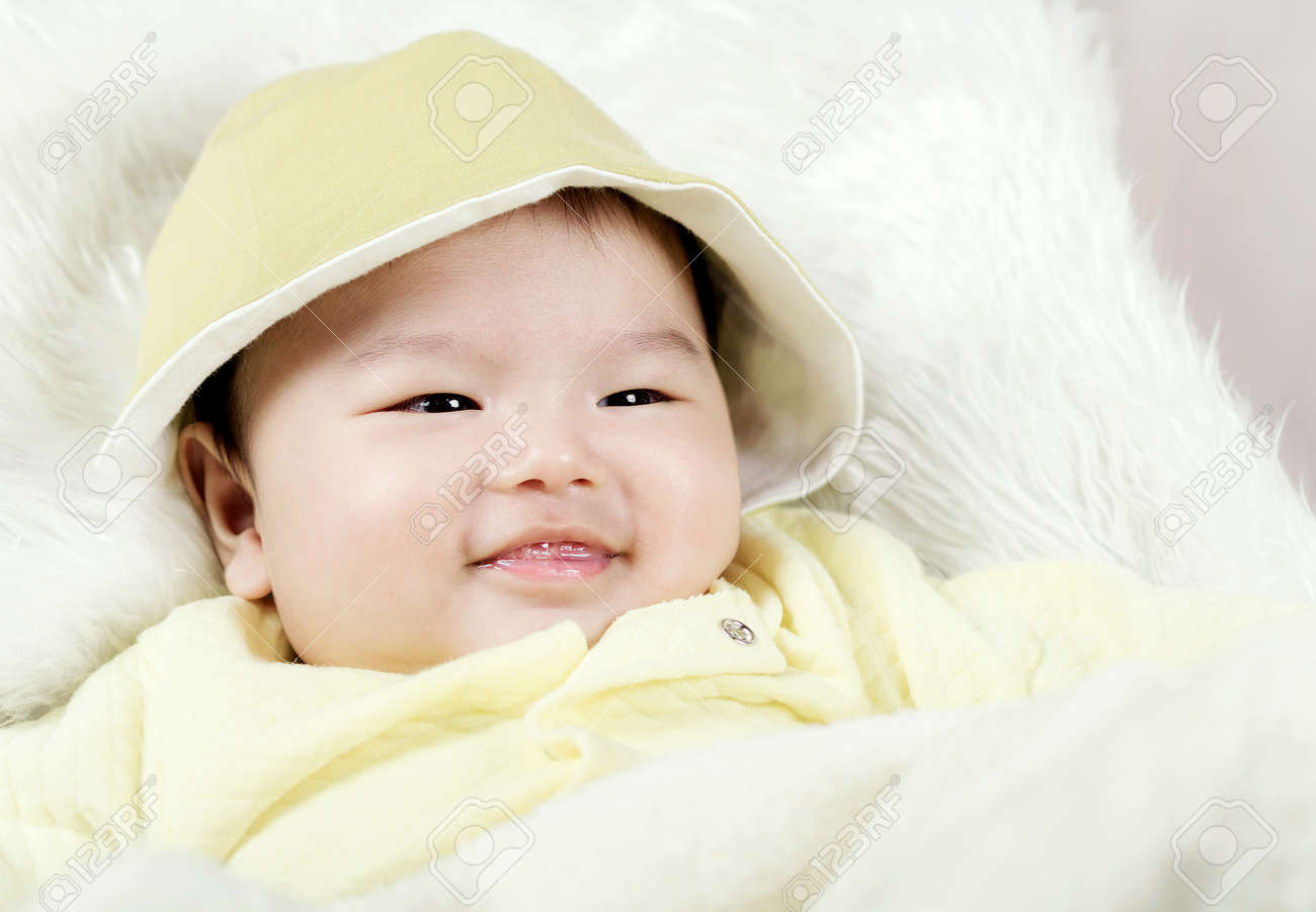Asian Baby Boy Lying On Bed Stock Photo   43998684