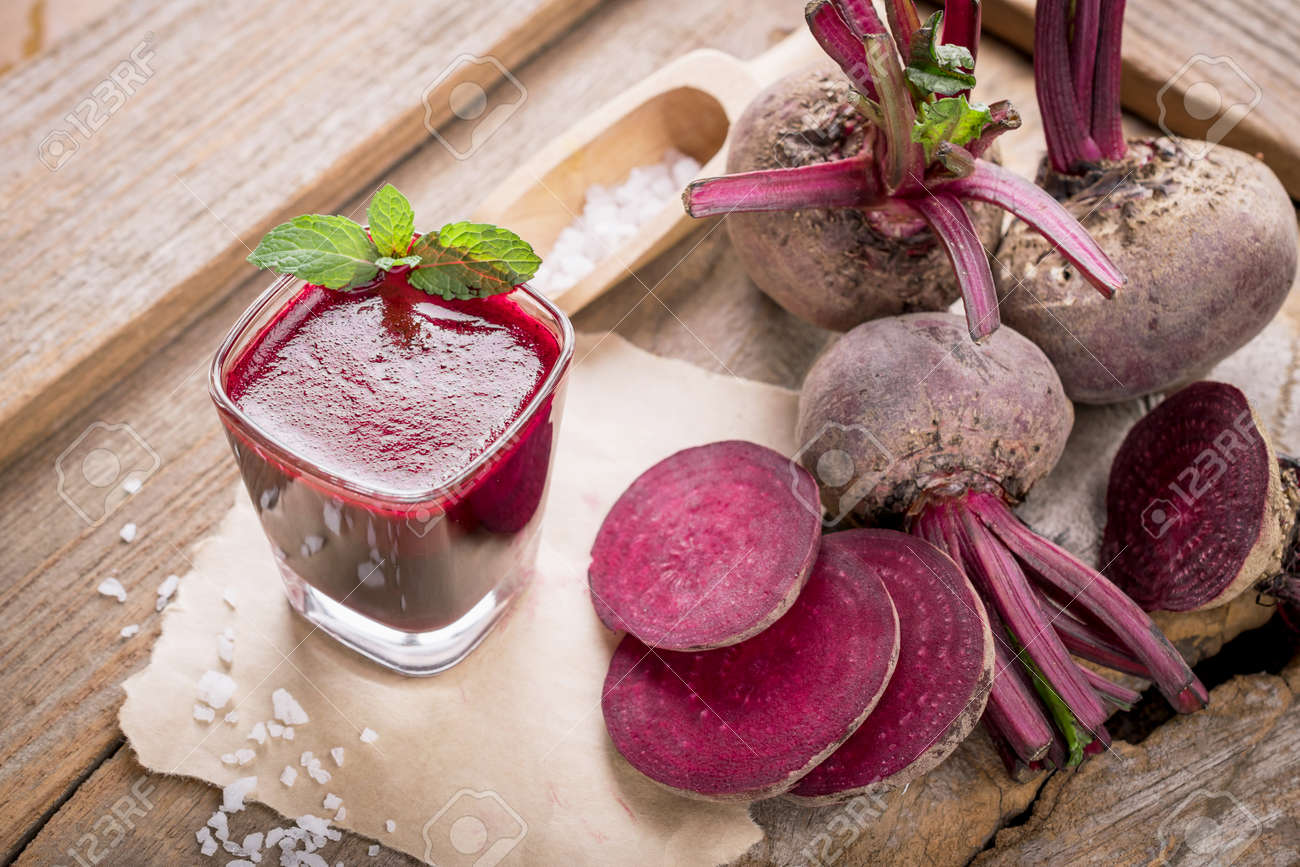 Beetroot juice,Healthy drink on wooden table. - 61667588