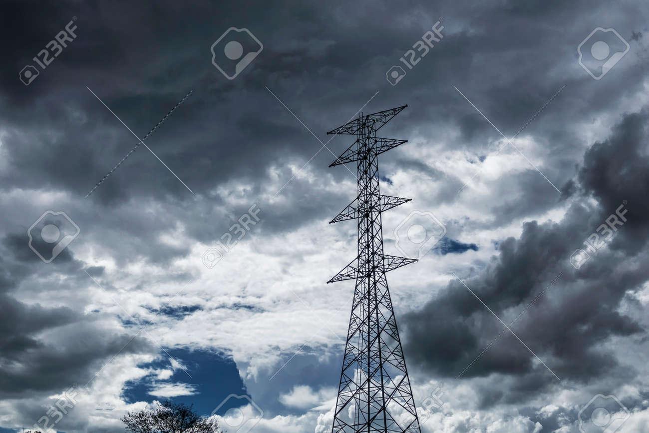high voltage pole Sky background rain clouds. - 126272316