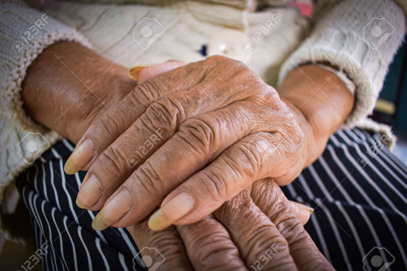 hand of the sick old woman rests on the lap. Mental health care at home. - 148558841