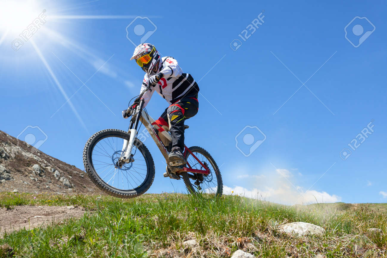 descent with mountain bike on a trail in the mountains - 138363355