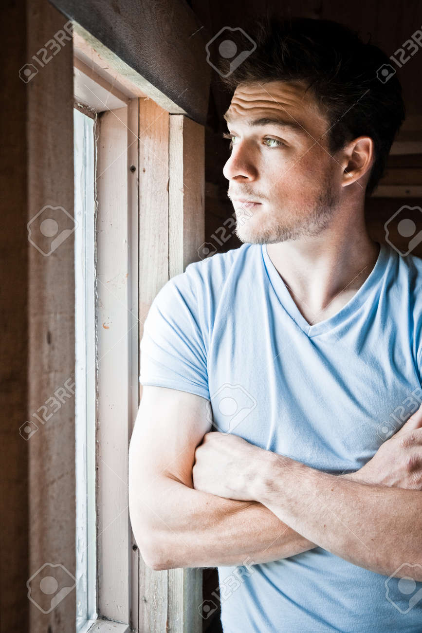 Young man at the window Stock Photo - 18862910