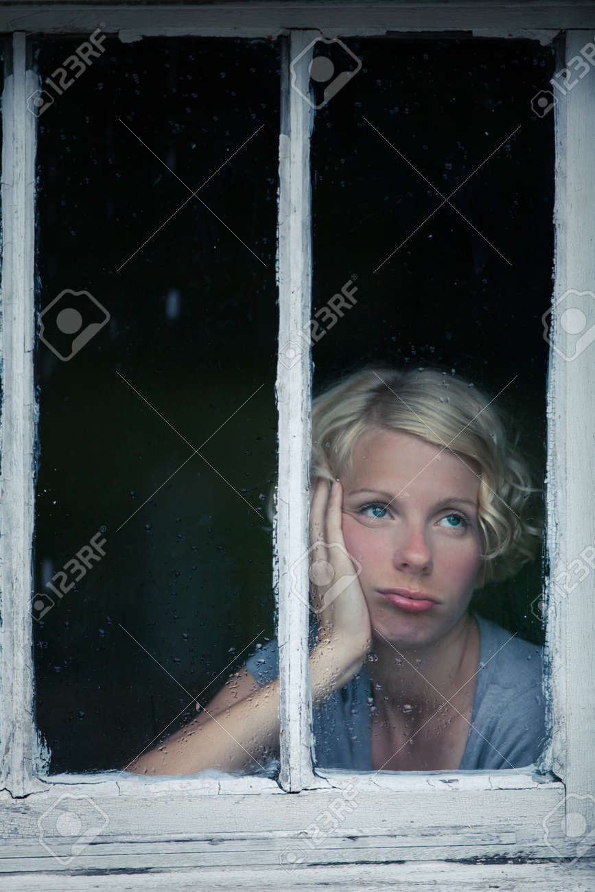 Bored Woman Looking at the Rainy Weather By the Window Frame - 23493993