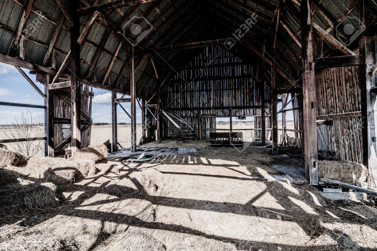 Old Abandoned Barn And Haystack Destroyed Walls Stock Photo