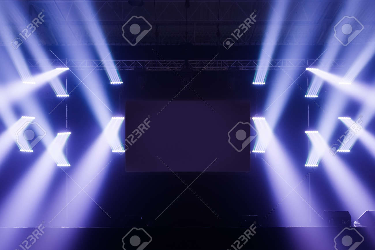 Spot Lights On A Empty Stage With Blank Screen In The Middle Before Big Concert