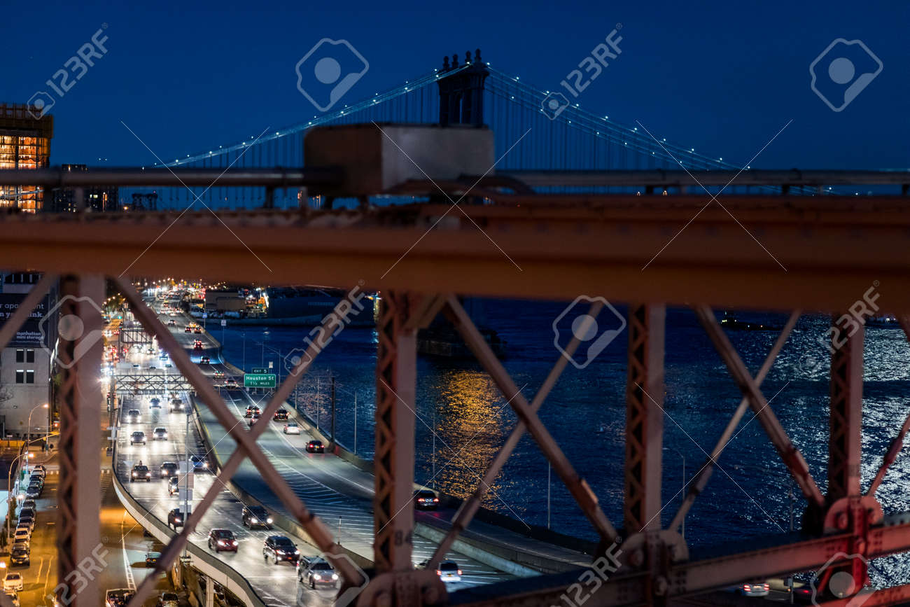 NEW YORK, USA - October 14, 2016. FDR Drive Highway at Night viewed from the Brooklyn Bridge, New York - 82385979