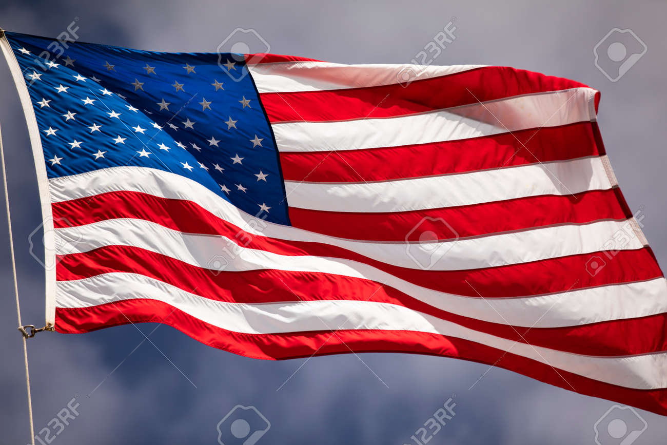 Flag of the USA flies in the wind - 145847149