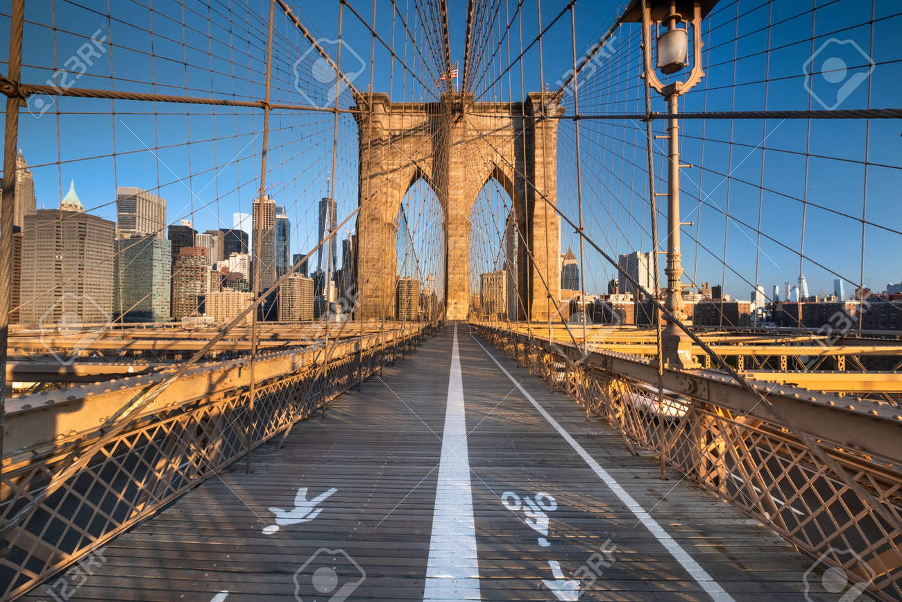 Pedestrian path over the Brooklyn Bridge connecting Manhattan New York City over the East River - 145878399