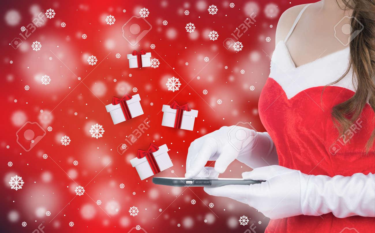 Christmas Woman Holding Smart Phone Sent Christmas Gifts On Winter ...
