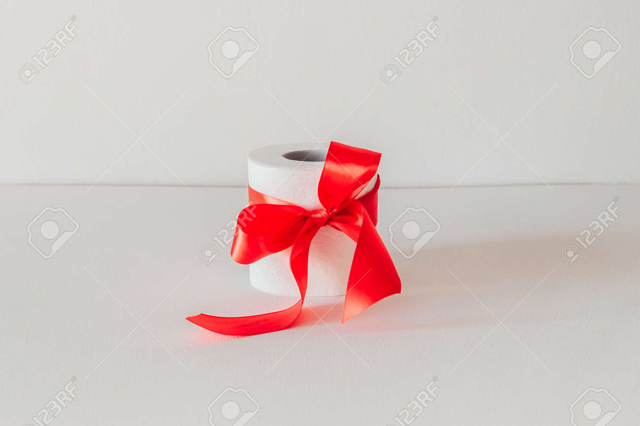 toilet paper with a red bow on a white background. - 145749513