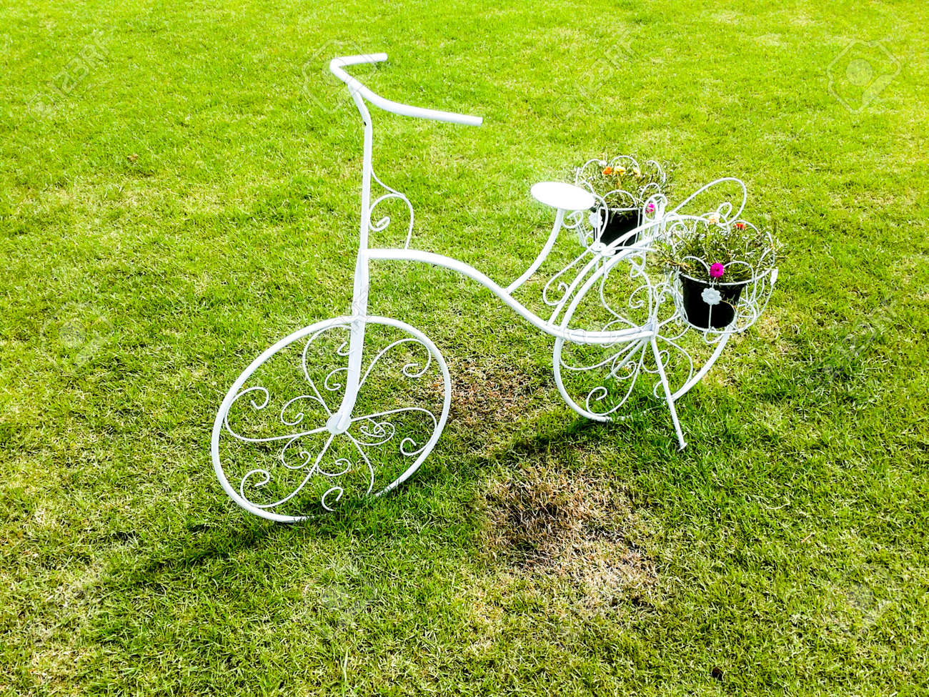 white bicycle standing on green meadow Stock Photo - 21576432