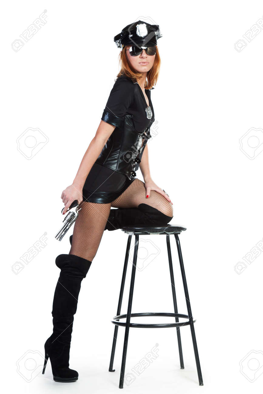 Sexy girl in police uniform on a white backgraund Stock Photo - 12050029