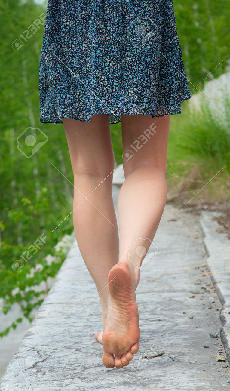 https://previews.123rf.com/images/afhunta/afhunta1201/afhunta120100102/11926422-a-young-woman-goes-barefoot-on-the-stone-parapet-Stock-Photo.jpg