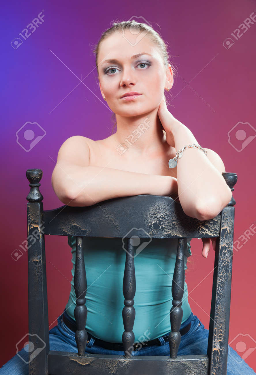 A young beautiful woman on a colored background Stock Photo - 16247142