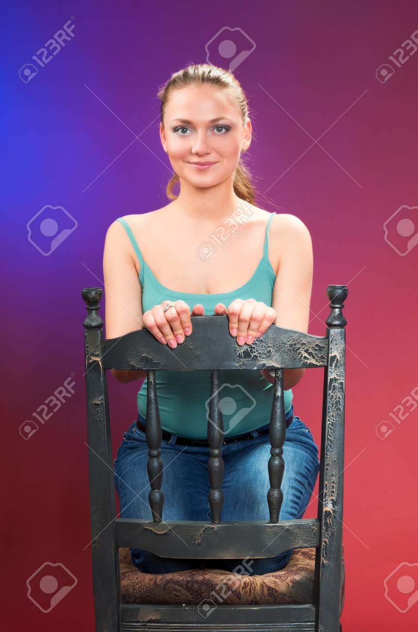 A young beautiful woman on a colored background Stock Photo - 16247112