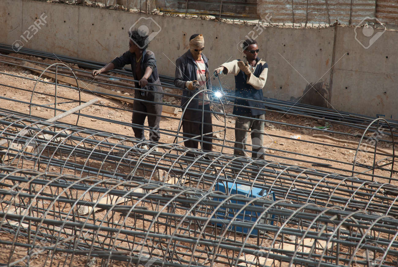 ADDIS ABABA, Ethiopia - FEBRUARY 4 2014:A team of welders on