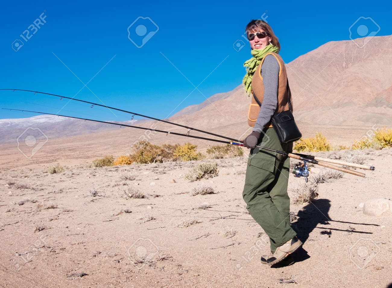 Young woman catching grayling in the river in Mongolia Stock Photo - 68537927
