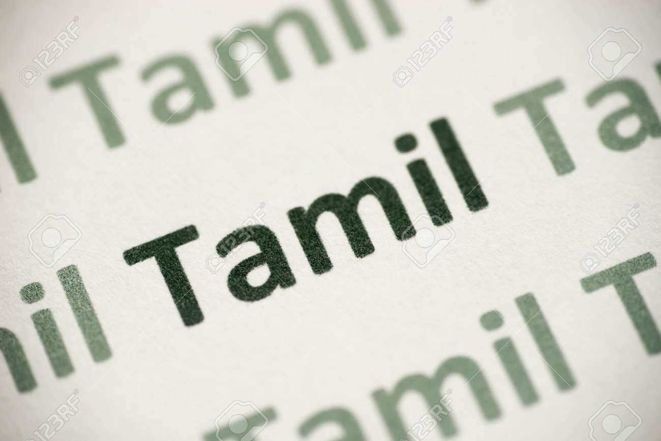 word Tamil language printed on white paper macro