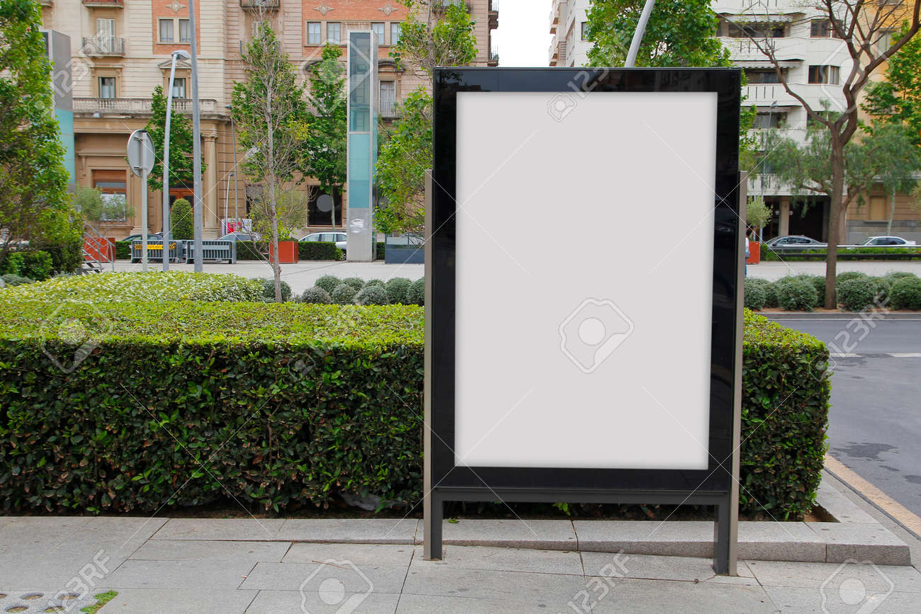 Blank billboard in the street, green plants Banque d'images - 57202054