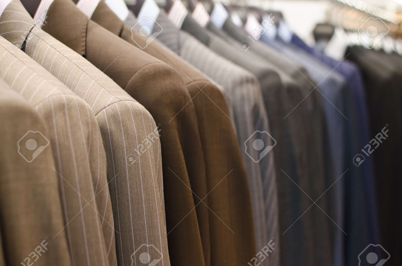 Men suits hanging in a clothing store. - 41692069