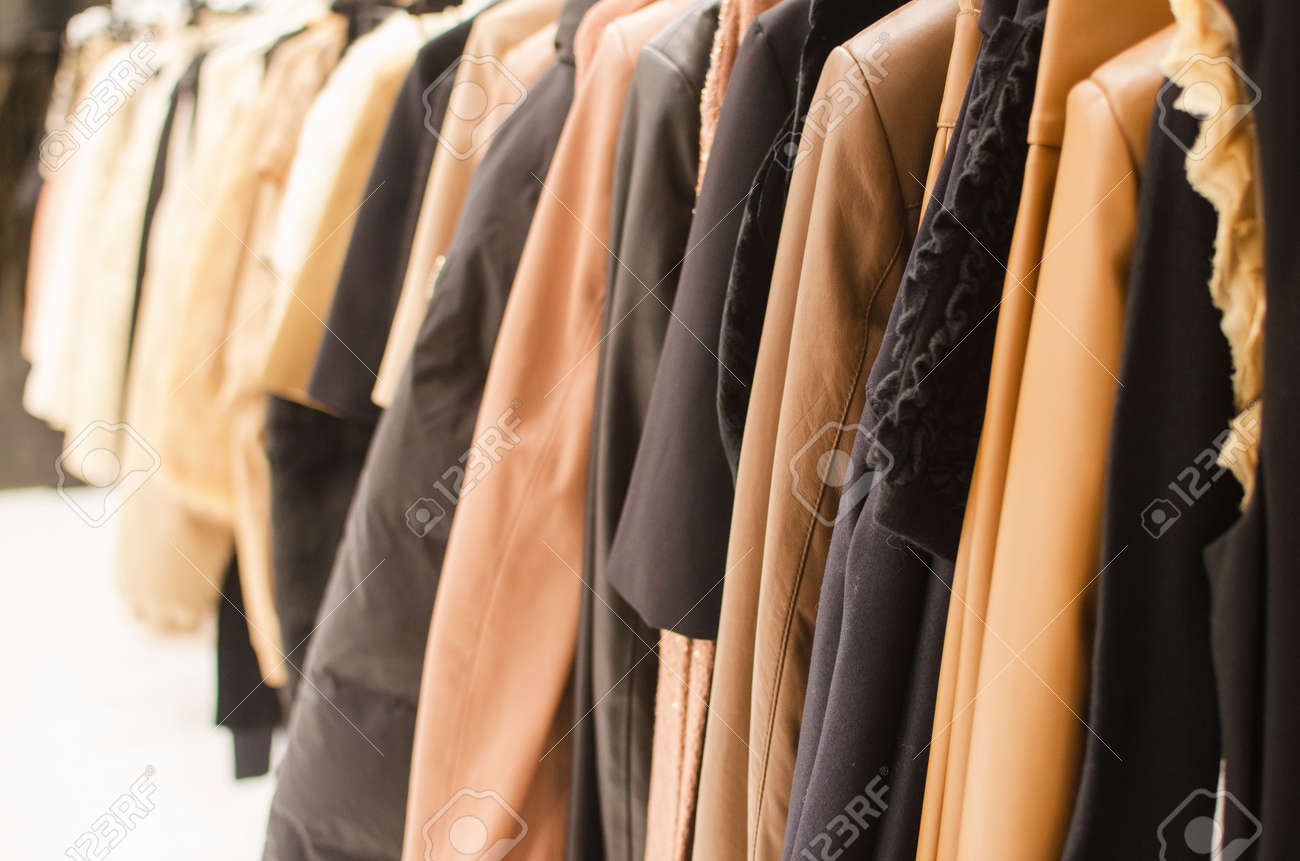 Hanging clothes in a fashion store. - 44113070