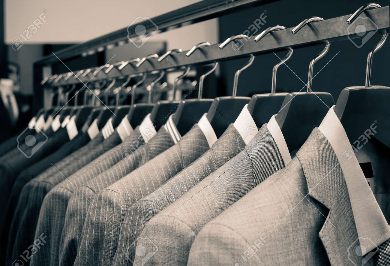 Men suits hanging in a clothing store. - 45886306
